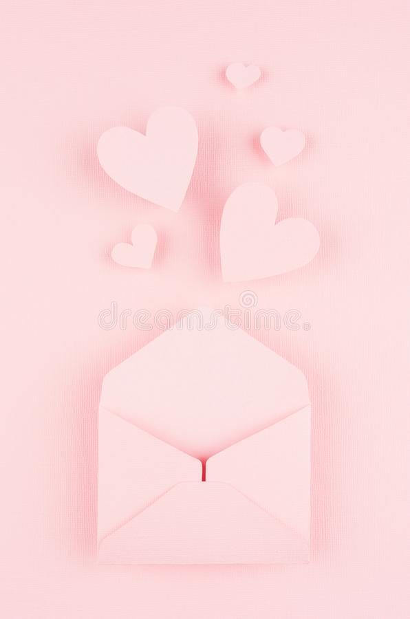 Valentines day background of pink paper envelop and stream soar small hearts on pink paper background. Valentines day background of pink paper envelop and stock photo