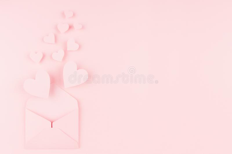 Valentines day background of pink paper envelop and stream soar small hearts on pink paper background. Copy space. Valentines day background of pink paper royalty free stock images