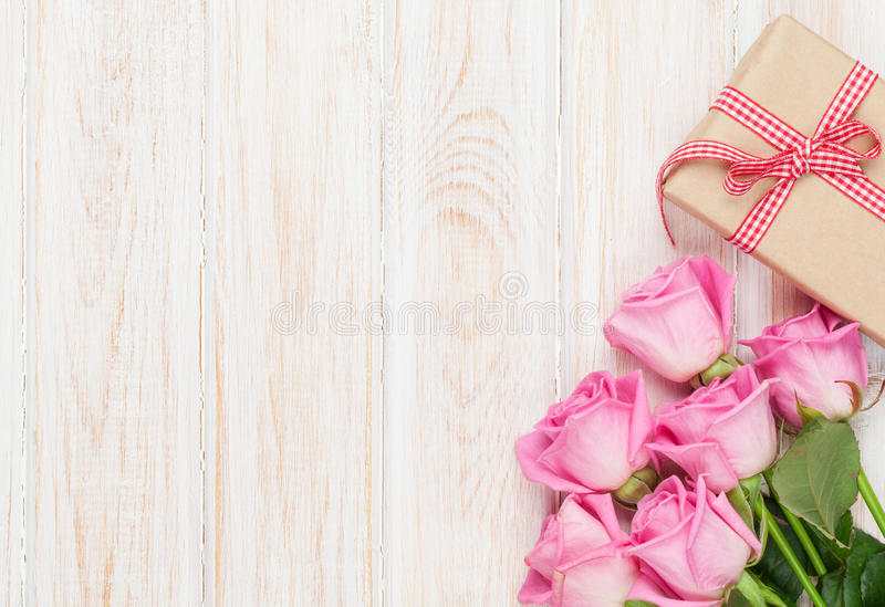 Valentines day background with pink roses and gift box royalty free stock photography