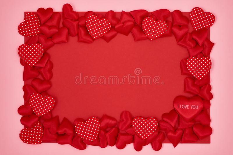 Valentines Day background. Red hearts boarder on white pink background. Top view, copy space royalty free stock image