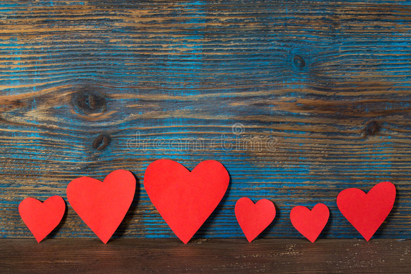Download Valentines Day Background Red Hearts In A Line On Wooden Stock Photo