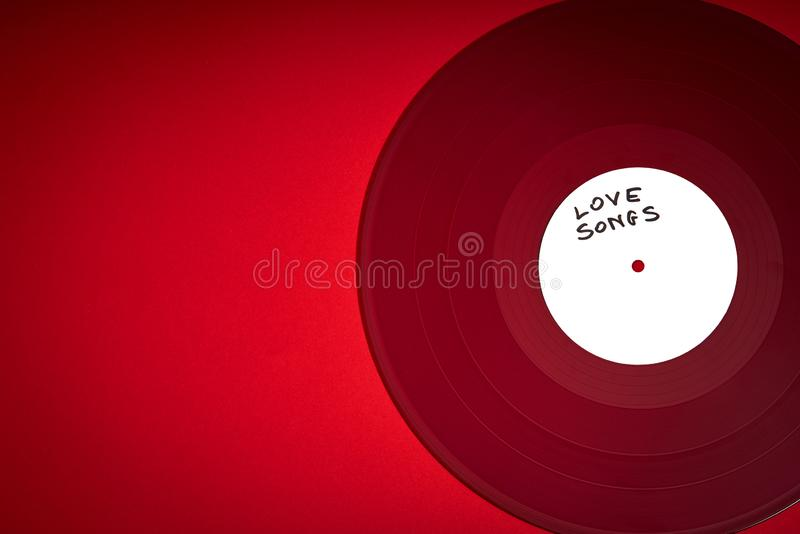 Valentines Day background with red LP record with love songs on red background royalty free stock photography