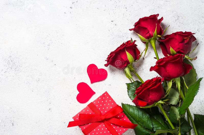 Valentines day background. Red roses, hearts and present on white. royalty free stock photography