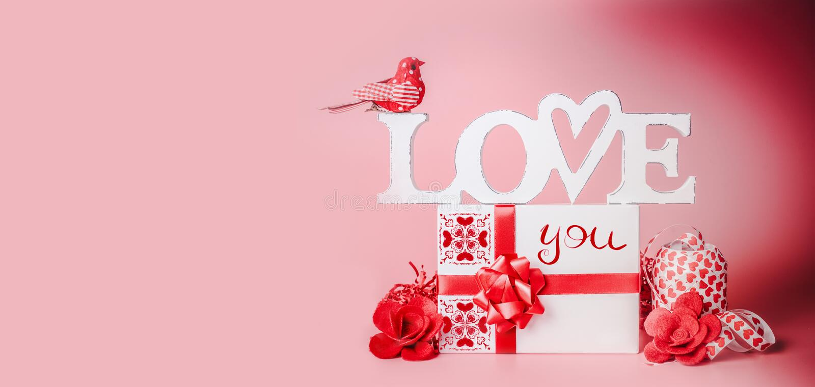 Valentines day background. Romantic composition with Love you message, gift box, red ribbons and hearts. Festive greeting concept royalty free stock photos
