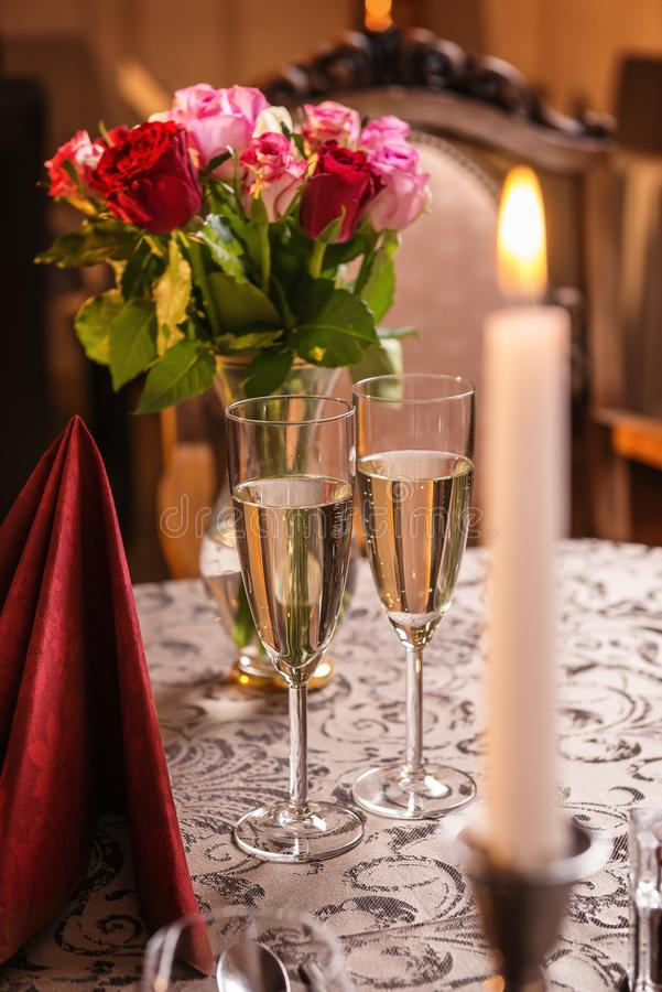 Valentines day background with roses and champagne in hotel or restaurant, romantic evening.  royalty free stock photography