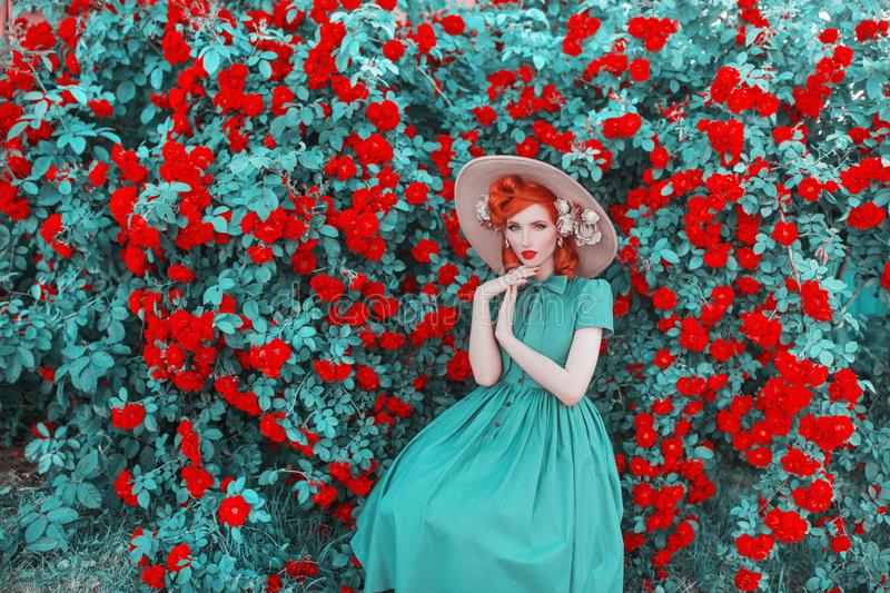 Valentines Day background. Spring rose flower garden. Sweet perfume. Trendy girl with red lips in dress. Gardening on farm. Flower. Perfume. Redhead woman on royalty free stock photo