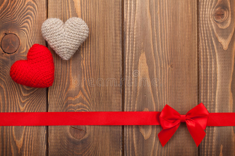 Valentines day background with toy hearts. Red ribbon and copy space stock photography