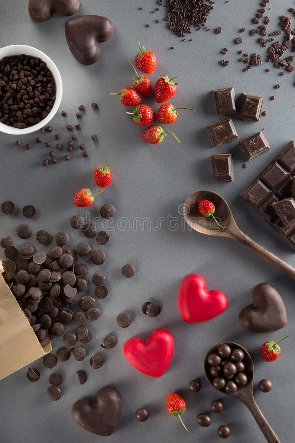 Free Valentines Day Background With Red And Dark Chocolates, Hearts A Stock Photo - 108060450