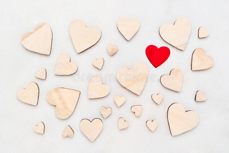 Valentines Day background with wooden hearts on a concrete background, top view. Valentines Day concept stock images
