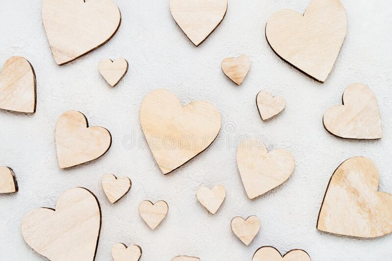 Valentines Day background with wooden hearts on a concrete background, top view. Valentines Day concept royalty free stock image
