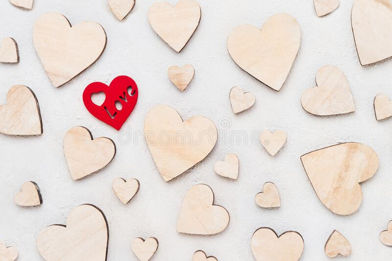 Valentines Day background with wooden hearts on a concrete background, top view. Valentines Day concept royalty free stock photos