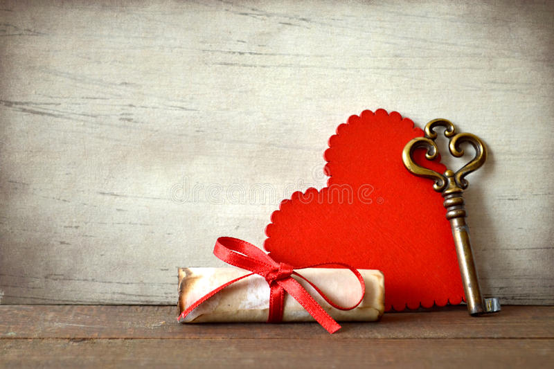 Valentines Day card with heart, key and love letter. On grunge background royalty free stock photography