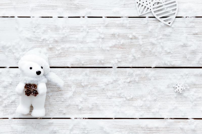 Valentines day card, snowflakes toy bear heart on white wooden romantic winter holiday background, top view, copy space. Snowflakes, hearts and toy bear on stock photography