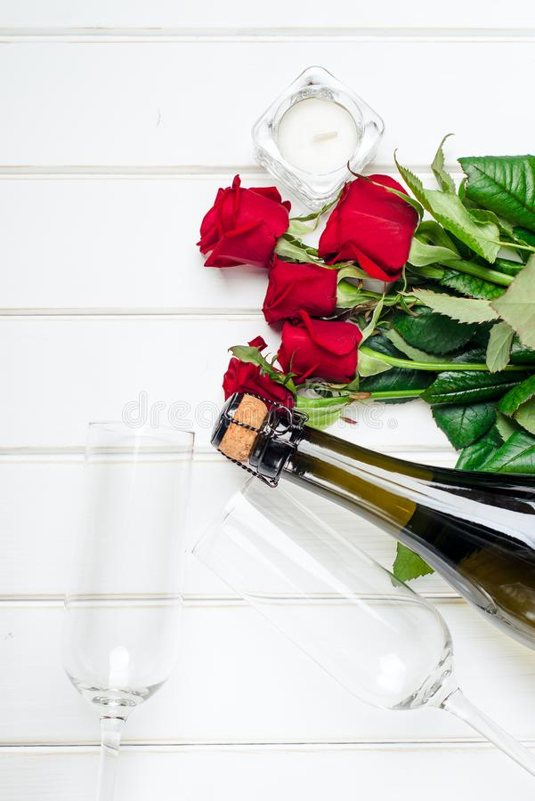 Valentines day cards. Bouquet of red roses on white wooden board. Top view. stock photo