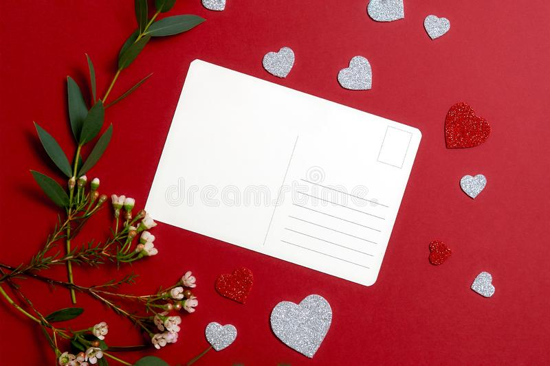 Valentines day composition. Love couple relationship concept. Valentines day composition : blank greeting postcard, green flowers bunch, heart shaped valentine royalty free stock photos