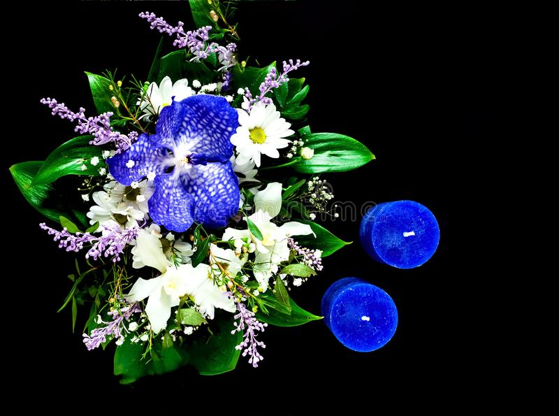 Valentines Day concept. Beautiful bouquet of spring flowers and blue candles on black background. n. Valentines Day concept. Beautiful bouquet of spring flowers stock photos