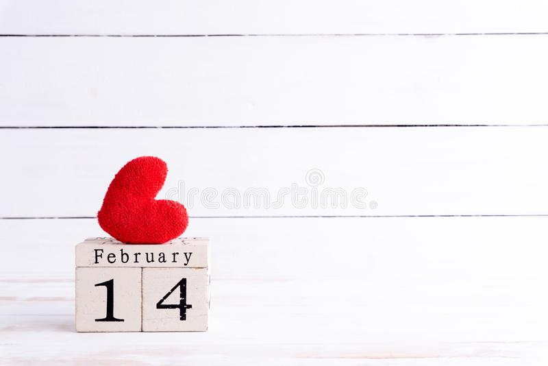 Valentines day concept. February 14 text on wooden block royalty free stock image