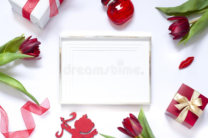Valentine`s day flat lay. Woman`s hands drawing a heart with red lipstick. Valentines day concept frame flat lay royalty free stock photography