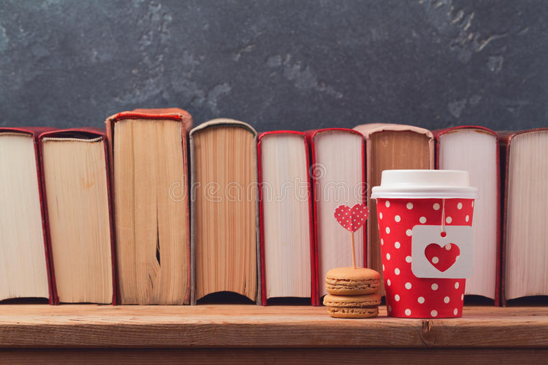 Valentines day concept with paper coffee cup, macarons and vintage books royalty free stock images