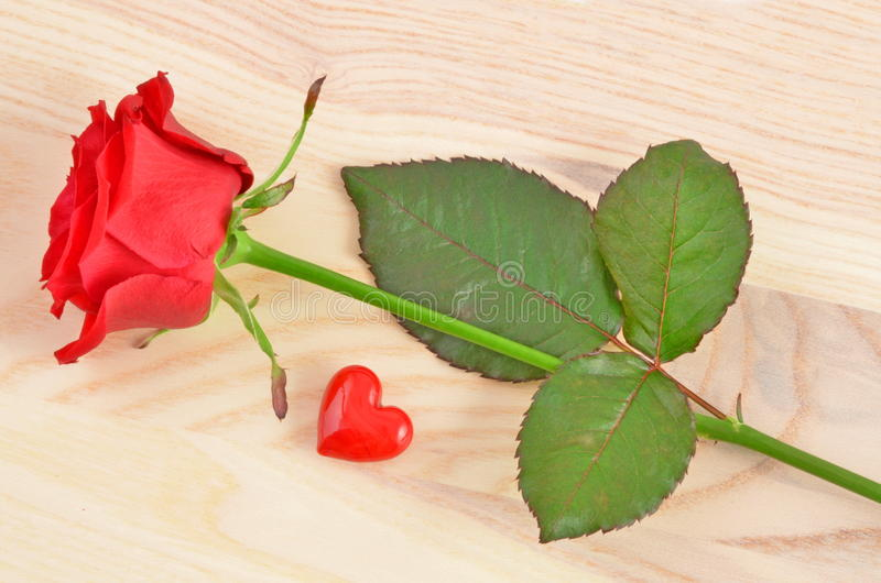 Valentines day concept. Red Rose and Heart. On wood background royalty free stock photography