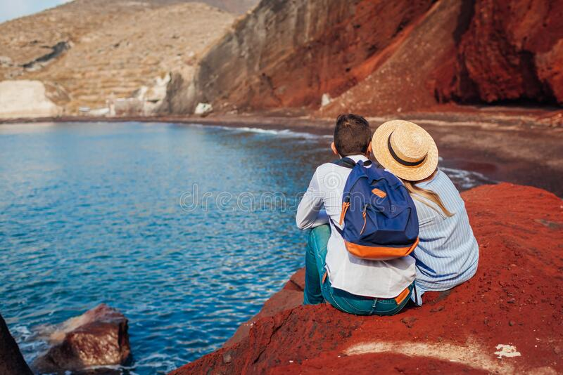 Valentines day. Couple in love enjoying honeymoon on Red beach in Santorini island, Greece. Vacation and traveling royalty free stock photo