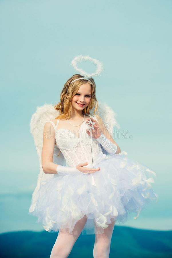 Valentines day cupid. Beauty blue her eyes - charming lady in the sunlight. Cupid cute girl with a bow. Happy teenage. Angel girl. Cute teen girl. Angel child stock images