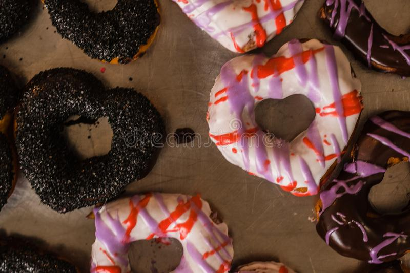 Valentines Day Donuts Full of Color. Assorted color and shapes of delicious donuts on a tray for Valentine`s Day stock photos