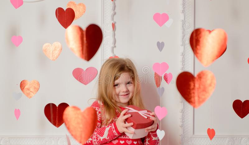 Valentines day. Family love. Girl cute child hearts decor background. Kid girl celebrate valentines day. Playful baby royalty free stock photo
