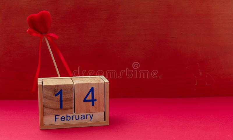 Valentines day. 14 February and a red velvet heart on red background stock photo