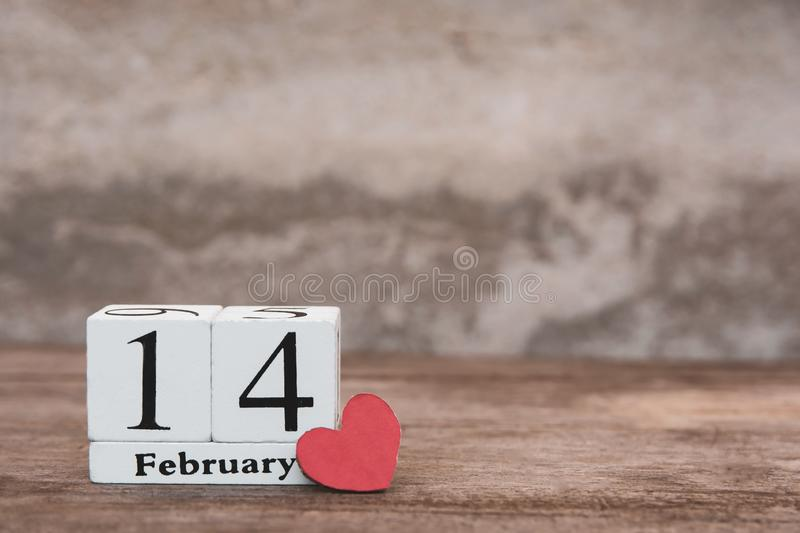 Valentines day with february 14th. Wooden white block calendar on wood table background with copy space stock images
