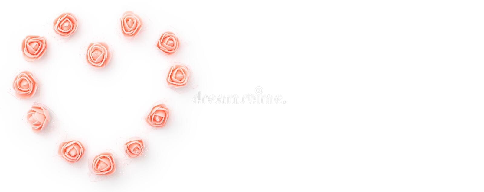 Valentines day floral background with coral or pink flowers rose shape heart flat lay. Mothers day, 8 March Women day. Top view. Valentines day floral stock image