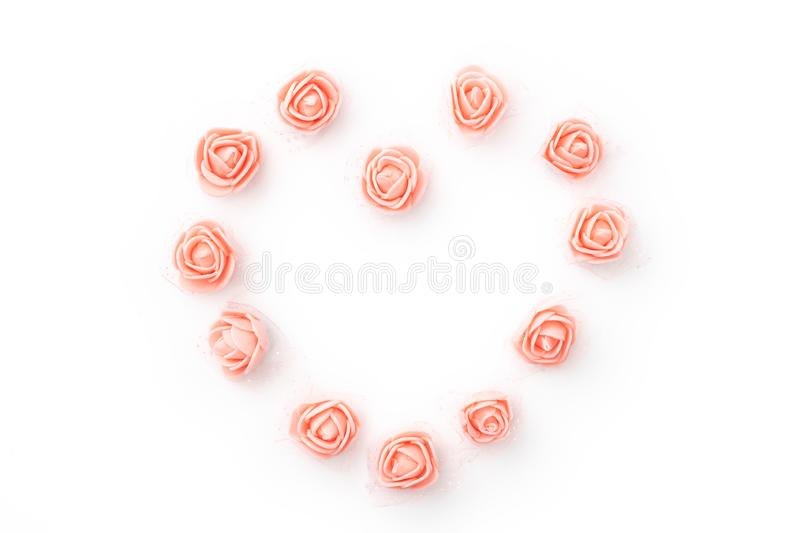 Valentines Day floral background with coral or pink flowers rose shape heart flat lay. Mothers day, 8 March Women day. Top view.  stock photo