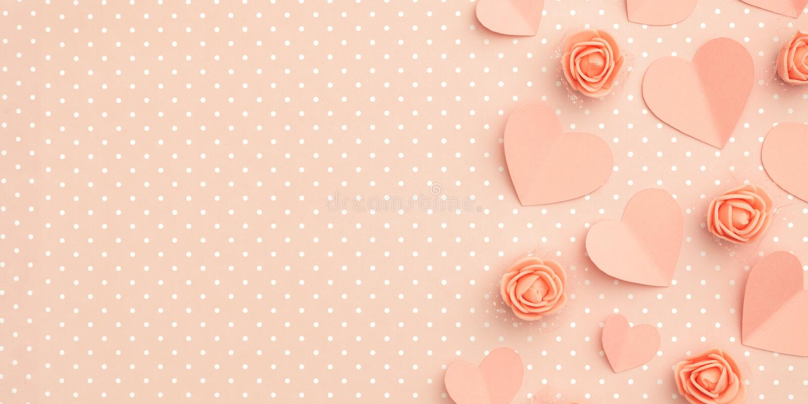 Valentines day floral composition with copy space. Love Day background with coral or pink flowers rose shape heart flat lay. Mothers day, 8 March Women day royalty free stock image