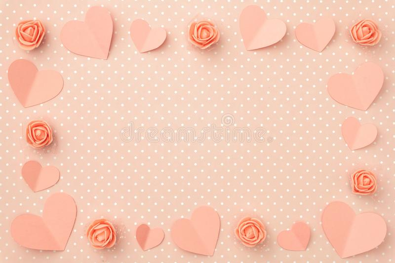 Valentines day floral composition with frame. Love Day background with coral or pink flowers rose shape heart flat lay. Mothers day, 8 March Women day. Top stock photos