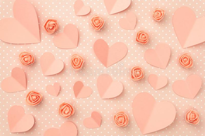 Valentines day floral coral composition. Love Day concept with coral flowers rose and heart flat lay on living coral background. Mothers day, 8 March Women day stock photo