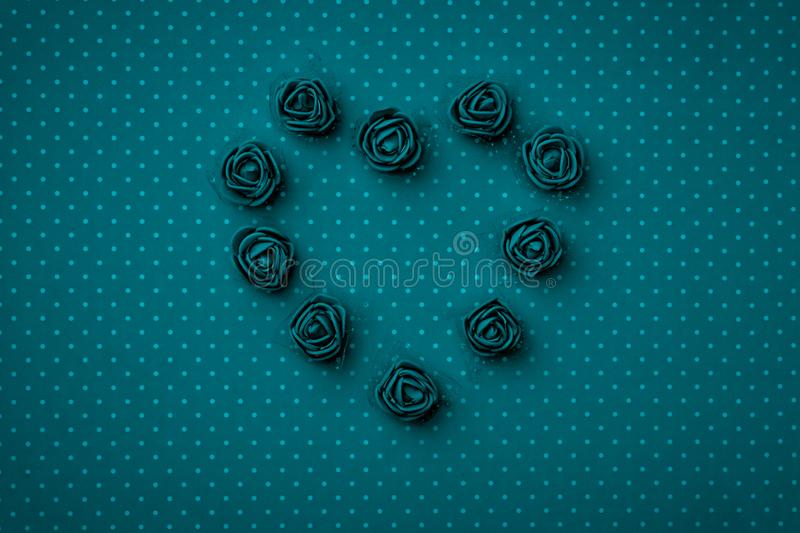 Valentines Day floral heart shape composition on dark blue or turquoise background. Mothers day, 8 March Womens day. Top view. Valentines Day floral heart shape stock photo