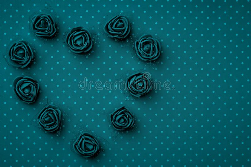 Valentines Day floral heart shape composition on dark blue or turquoise background. Mothers day, 8 March Womens day. Top view. Valentines Day floral heart shape stock photos