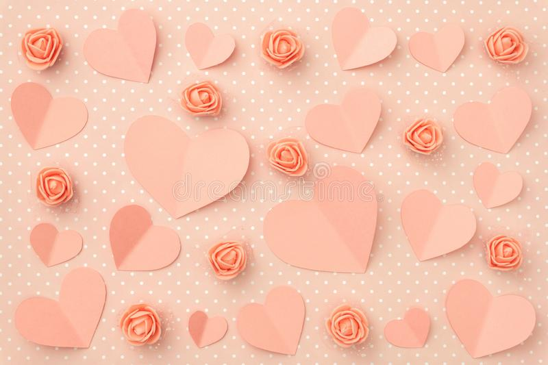 Valentines day floral pattern. Love Day background with coral or pink flowers rose shape heart flat lay. Top view. Valentines day floral pattern. Love Day stock photo