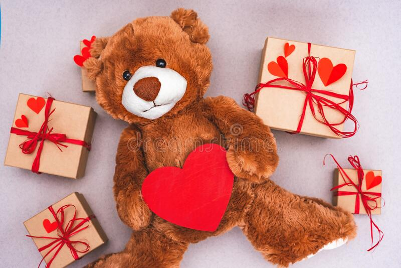 Teddy Bear with red heart and gift box. Valentines Day creative greeting card royalty free stock photos