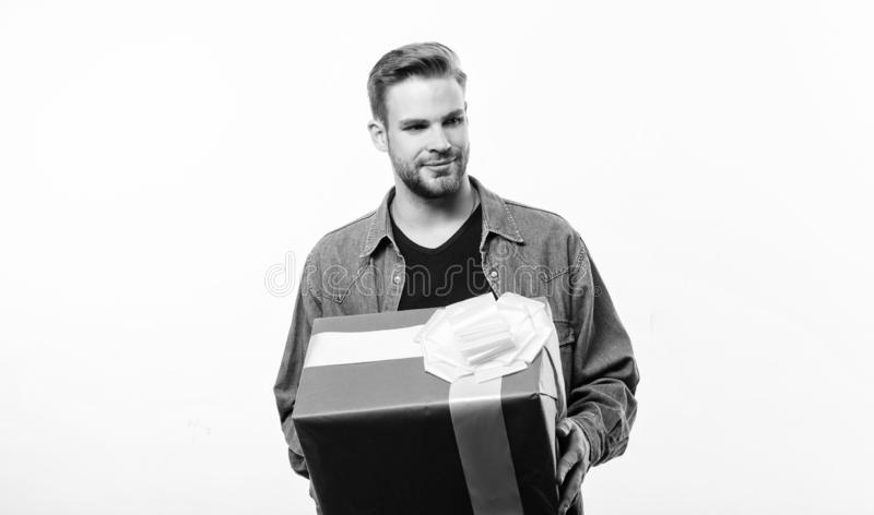Valentines day gift. Male fashion. Handsome macho man. Love date. Happy birthday. Man share present. Romantic greeting. Boxing day. unshaven man with present stock photos