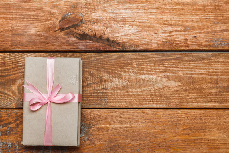 Valentines Day gift on wooden background. Valentines Day gift in box on wooden background royalty free stock image