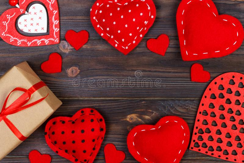 Valentines day greeting card. Handmaded hearts on wooden table. Top view, copy space stock photos