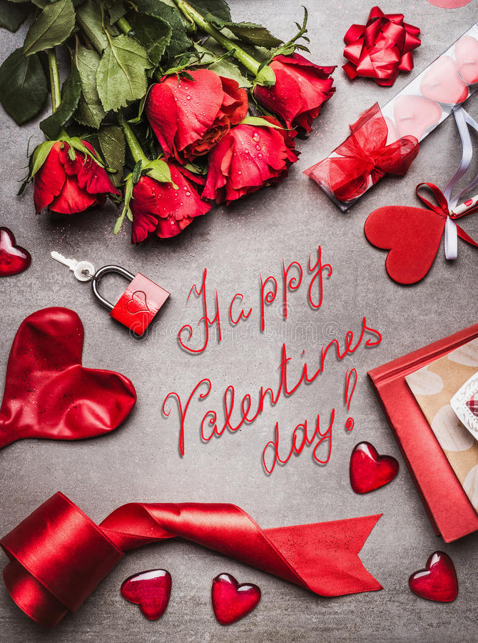 Valentines day greeting card with love symbols , red decoration and beautiful roses bunch, and handwritten lettering Happy Valenti stock images