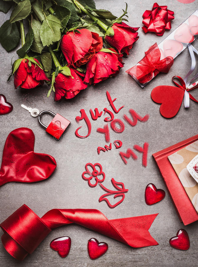 Valentines day greeting card with love symbols , red decoration and roses and handwritten lettering Just you and my, top view stock images