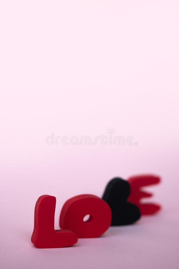 Valentines day greeting card with love word over blackboard. With space for your greetings.  royalty free stock images