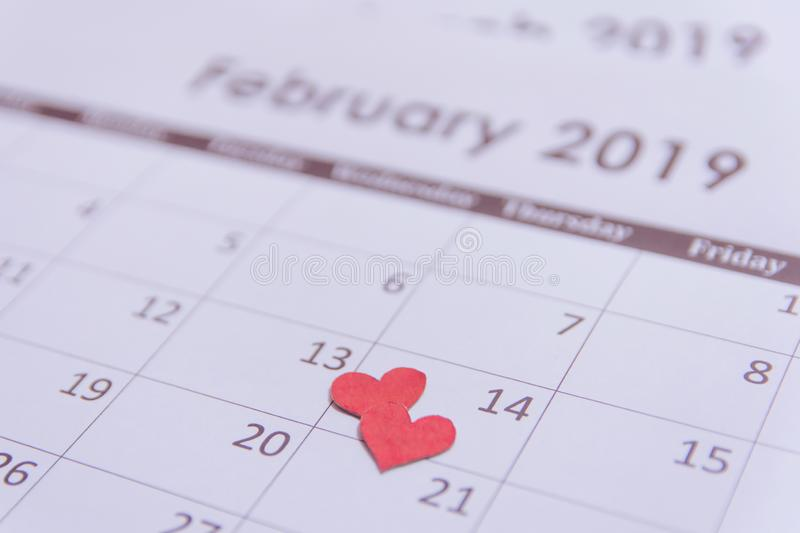 Valentines day greeting card. Red hearts paper on Calendar page February 14 with copy space royalty free stock photo