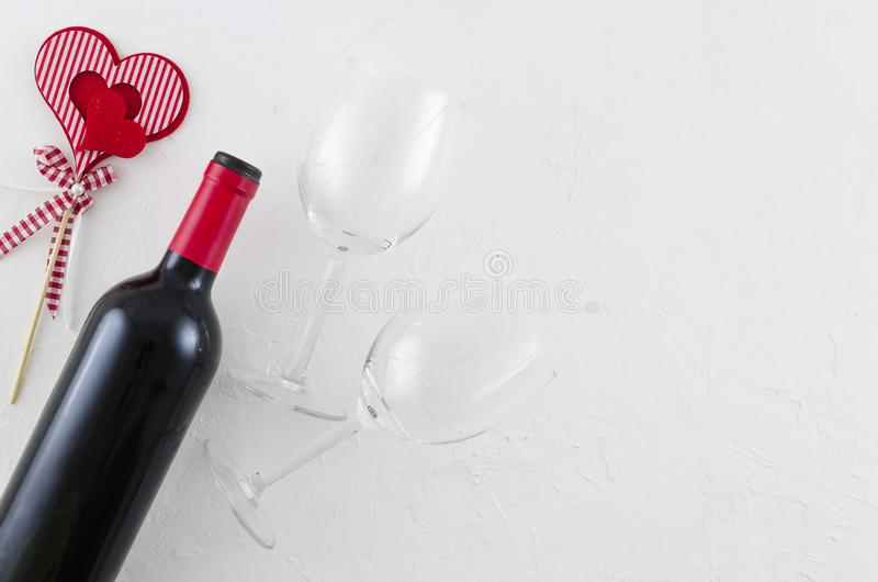 Valentines day greeting card. Top view mockup with space for your greetings. Wine bottle, red heart and wineglass on stock image