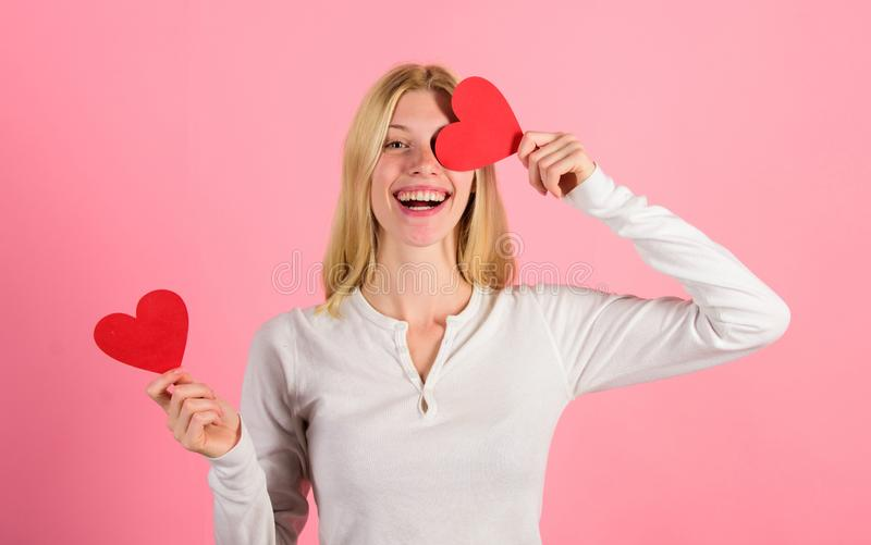 Valentines day has traditionally been seen as more significant for women. Girl hold heart symbol love and romantic pink. Background. Woman celebrate love. Girl royalty free stock photo