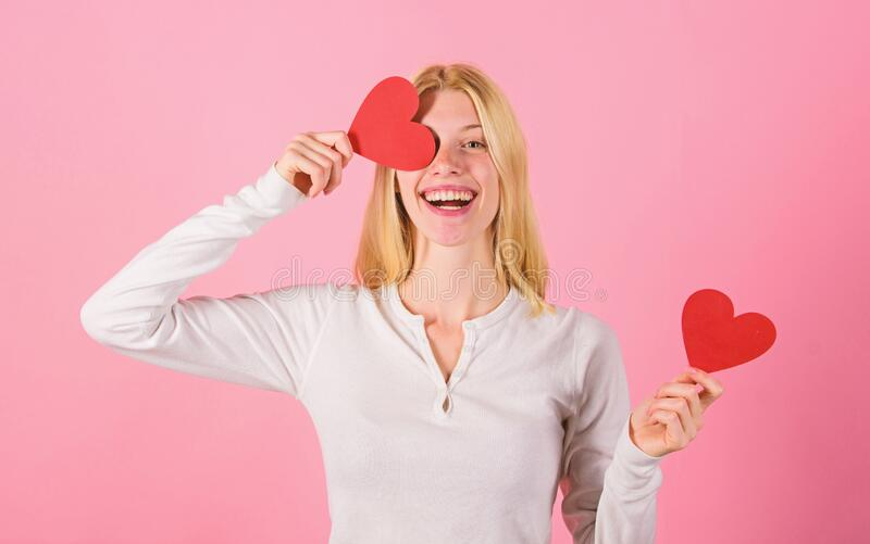 Valentines day has traditionally been seen as more significant for women. Girl hold heart symbol love and romantic pink stock images