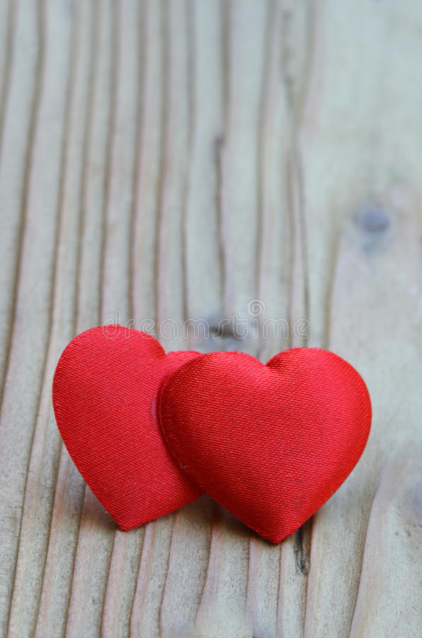 VALENTINES DAY HEART. Two Red hearts on wood background stock photos